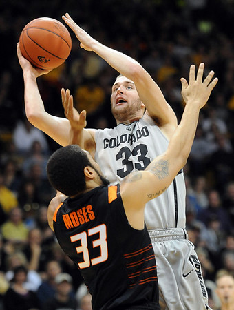 """Austin Dufault of CU shoots over Marshall Moses of Oklahoma State.<br /> For more photos of the game, go to  <a href=""""http://www.dailycamera.com"""">http://www.dailycamera.com</a>.<br /> Cliff Grassmick / January 15, 2011"""