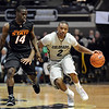 "Shannon Sharpe of CU dribbles past Ray Penn of OSU.<br /> For more photos of the game, go to  <a href=""http://www.dailycamera.com"">http://www.dailycamera.com</a>.<br /> Cliff Grassmick / January 15, 2011"