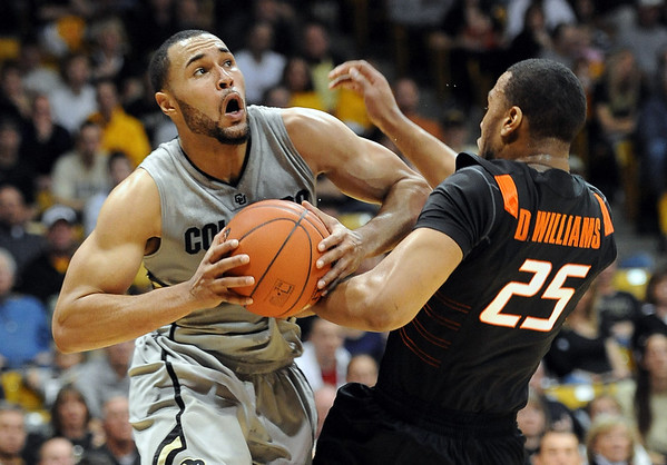 "Marcus Relphorde, left, of Colorado, gets called for a charge into Darrell Williams of Oklahoma State during the first half of the January 15, 2011 game in Boulder.<br /> For more photos of the game, go to  <a href=""http://www.dailycamera.com"">http://www.dailycamera.com</a>.<br /> Cliff Grassmick / January 15, 2011"