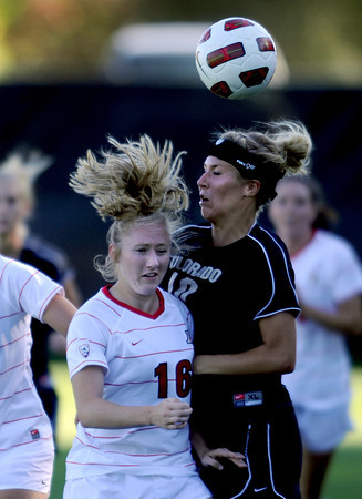 "Kirstyn Magyar, left, of Arizona, and Amy Barczuk of CU, battle in the game on Friday.<br /> For more photos of the game, go to  <a href=""http://www.dailycamera.com"">http://www.dailycamera.com</a><br /> Cliff Grassmick / September 30, 2011"