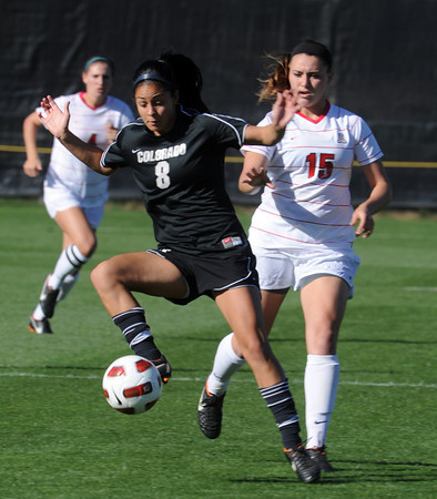 """Quinn Krier, left, of CU, keeps the ball from Ariel Boulicault of Arizona.<br /> For more photos of the game, go to  <a href=""""http://www.dailycamera.com"""">http://www.dailycamera.com</a><br /> Cliff Grassmick / September 30, 2011"""