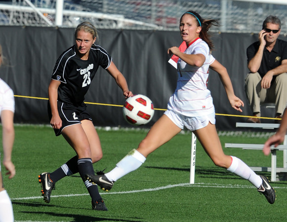 """Anne Stuller, left, of CU, kicks the ball in front of the goal past Brie DeFelice of Arizona.<br /> For more photos of the game, go to  <a href=""""http://www.dailycamera.com"""">http://www.dailycamera.com</a><br /> Cliff Grassmick / September 30, 2011"""