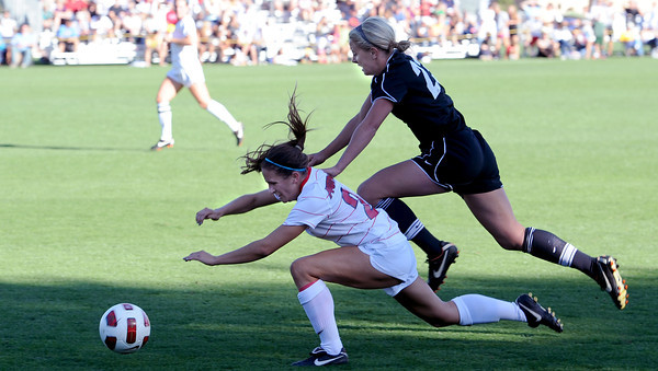 "Anne Stuller of CU, tries to push through Shannon Heinzler of Arizona, to get to the ball.<br /> For more photos of the game, go to  <a href=""http://www.dailycamera.com"">http://www.dailycamera.com</a><br /> Cliff Grassmick / September 30, 2011"