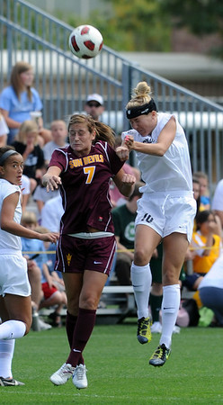 "Courtney Tinnin of ASU, and Amy Barczuk of CU, go up to connect on the header.<br /> For more photos of the game, go to  <a href=""http://www.dailycamera.com"">http://www.dailycamera.com</a><br /> Cliff Grassmick / October 2, 2011"