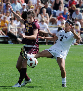 Quinn Krier of CU gets the ball from Alyssa Freeman of ASU. For more photos of the game, go to www.dailycamera.com Cliff Grassmick / October 2, 2011