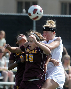 Holland Crook (15) of ASU, and Amy Barczuk of CU, go up to connect on the header. For more photos of the game, go to www.dailycamera.com Cliff Grassmick / October 2, 2011