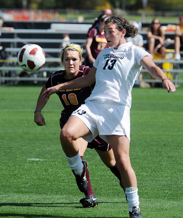 "Kate Russell (13) of CU, gets control of the ball in front of Kari Shane of ASU.<br /> For more photos of the game, go to  <a href=""http://www.dailycamera.com"">http://www.dailycamera.com</a><br /> Cliff Grassmick / October 2, 2011"
