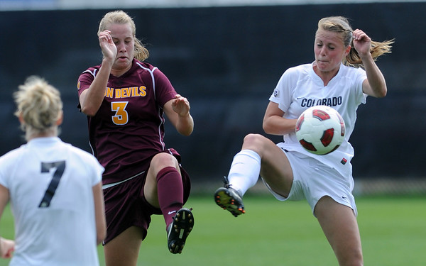 "Sierra Cook, left, of ASU, and Hayley Hughes of CU, appear to dance around the ball.<br /> For more photos of the game, go to  <a href=""http://www.dailycamera.com"">http://www.dailycamera.com</a><br /> Cliff Grassmick / October 2, 2011"