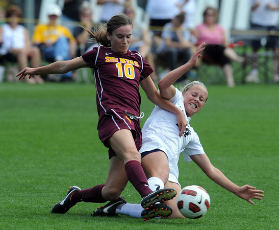 "Jasmine Roth, left, of Arizona State, and Anne Stuller of CU, collide going for the ball.<br /> For more photos of the game, go to  <a href=""http://www.dailycamera.com"">http://www.dailycamera.com</a><br /> Cliff Grassmick / October 2, 2011"
