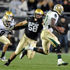 Tyler Ahles of CU tracks down Robert Griffin III of Baylor.<br /> Cliff Grassmick / October 16, 2010