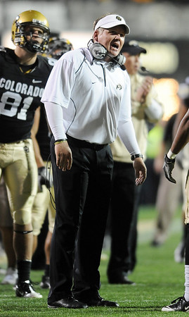 "Dan Hawkins talks to his players after a CU fumble against Baylor.<br /> For more photos of the game, go to  <a href=""http://www.dailycamera.com"">http://www.dailycamera.com</a><br /> Cliff Grassmick / October 16, 2010"