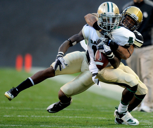 """University of Colorado cornerback Jimmy Smith makes a tackle on Baylor freshman Tevin Reese during the football game on Saturday, Oct. 16, at Folsom Field in Boulder.<br /> For more photos go to  <a href=""""http://www.dailycamera.com"""">http://www.dailycamera.com</a><br /> Photo by Jeremy Papasso/ Camera"""