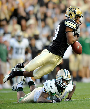 """University of Colorado freshman Deji Olatoye misses an interception in the second quarter of the football game against Baylor on Saturday, Oct. 16, at Folsom Field in Boulder.<br /> For more photos go to  <a href=""""http://www.dailycamera.com"""">http://www.dailycamera.com</a><br /> Photo by Jeremy Papasso/ Camera"""