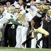 "University of Colorado senior Travon Patterson makes a catch for big yardage in the second quarter of the football game against Baylor on Saturday, Oct. 16, at Folsom Field in Boulder.<br /> For more photos go to  <a href=""http://www.dailycamera.com"">http://www.dailycamera.com</a><br /> Photo by Jeremy Papasso/ Camera"