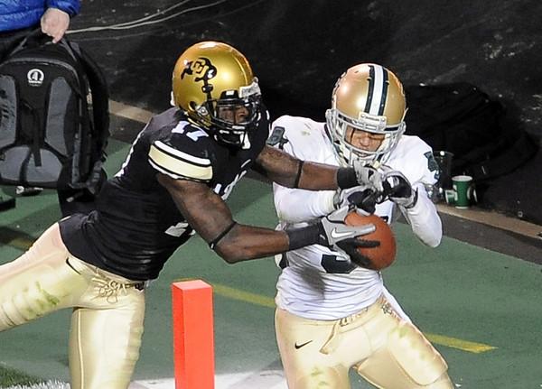 """Toney Clemons of CU tries to make this catch on the last play of the game as Chance Casey of Baylor defends. The catch could have scored the game winning score with the extra point.<br /> For more photos of the game, go to  <a href=""""http://www.dailycamera.com"""">http://www.dailycamera.com</a><br /> Cliff Grassmick / October 16, 2010"""