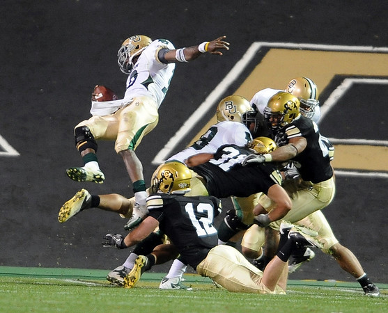 """Baylor QB Robert Griffin III flies into the endzone, but the play is called back.<br /> For more photos of the game, go to  <a href=""""http://www.dailycamera.com"""">http://www.dailycamera.com</a><br /> Cliff Grassmick / October 16, 2010"""