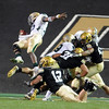 "Baylor QB Robert Griffin III flies into the endzone, but the play is called back.<br /> For more photos of the game, go to  <a href=""http://www.dailycamera.com"">http://www.dailycamera.com</a><br /> Cliff Grassmick / October 16, 2010"