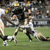 "University of Colorado quarterback Tyler Hansen rushes the ball in the fourth quarter before being taken down by a Baylor defender during the football game against Baylor on Saturday, Oct. 16, at Folsom Field in Boulder. Baylor defeated CU 31-25.<br /> For more photos go to  <a href=""http://www.dailycamera.com"">http://www.dailycamera.com</a><br /> Photo by Jeremy Papasso/ Camera"