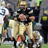 Tyler Hansen  of CU looks down field to pass against Baylor.<br /> Cliff Grassmick / October 16, 2010