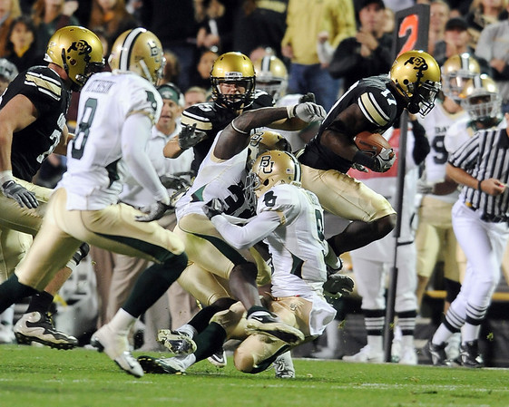 "Toney Clemons of  tries to get extra yardage against Baylor on Saturday.<br /> For more photos of the game, go to  <a href=""http://www.dailycamera.com"">http://www.dailycamera.com</a><br /> Cliff Grassmick / October 16, 2010"