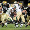 Will Pericak (83) and Curtis Cunningham of CU, try to contain Robert Griffin III of Baylor.<br /> Cliff Grassmick / October 16, 2010