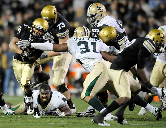 """University of Colorado tailback Rodney Stewart rushes the ball through Baylor defenders during the football game against Baylor on Saturday, Oct. 16, at Folsom Field in Boulder. Baylor defeated CU 31-25.<br /> For more photos go to  <a href=""""http://www.dailycamera.com"""">http://www.dailycamera.com</a><br /> Photo by Jeremy Papasso/ Camera"""