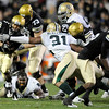 "University of Colorado tailback Rodney Stewart rushes the ball through Baylor defenders during the football game against Baylor on Saturday, Oct. 16, at Folsom Field in Boulder. Baylor defeated CU 31-25.<br /> For more photos go to  <a href=""http://www.dailycamera.com"">http://www.dailycamera.com</a><br /> Photo by Jeremy Papasso/ Camera"