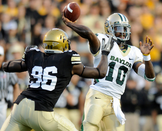 """University of Colorado freshman Chidera Uzo-Diribe puts pressure on Baylor quarterback Robert Griffin III during the football game on Saturday, Oct. 16, at Folsom Field in Boulder.<br /> For more photos go to  <a href=""""http://www.dailycamera.com"""">http://www.dailycamera.com</a><br /> Photo by Jeremy Papasso/ Camera"""