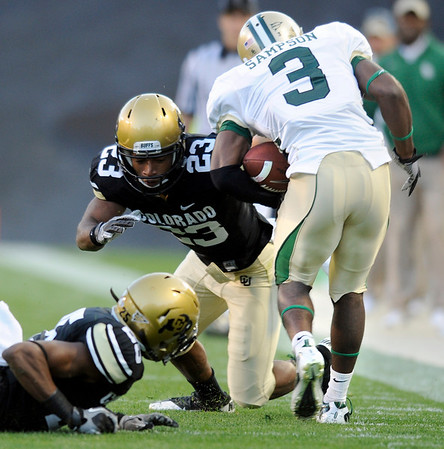"University of Colorado senior Jalil Brown tackles Baylor receiver Lanear Sampson during the football game on Saturday, Oct. 16, at Folsom Field in Boulder.<br /> For more photos go to  <a href=""http://www.dailycamera.com"">http://www.dailycamera.com</a><br /> Photo by Jeremy Papasso/ Camera"
