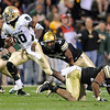 "Baylor QB, Robert Griffin III was difficult to stop for the Buffs.<br /> For more photos of the game, go to  <a href=""http://www.dailycamera.com"">http://www.dailycamera.com</a><br /> Cliff Grassmick / October 16, 2010"