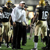 CU coach Dan Hawkins talks to Will Jefferson during the Baylor game.<br /> Cliff Grassmick / October 16, 2010