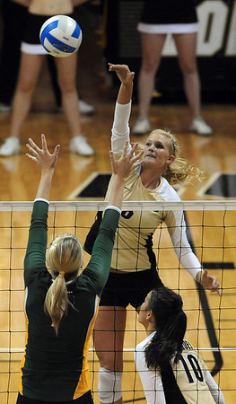 "Kerra Schroeder of CU hits over Torri Campbell of Baylor.<br /> For more photos of the game, go to  <a href=""http://www.dailycamera.com"">http://www.dailycamera.com</a><br /> Cliff Grassmick / October 9, 2010"