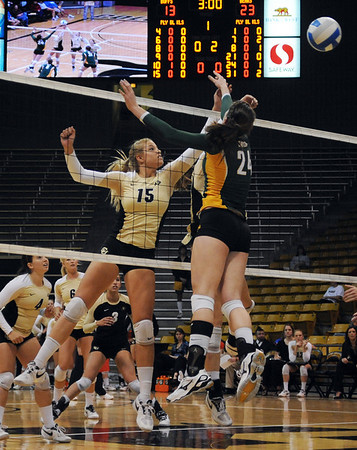 "Nikki Lindow of Colorado hits the ball over Ashlie Christenson of Baylor.<br /> For more photos of the game, go to  <a href=""http://www.dailycamera.com"">http://www.dailycamera.com</a><br /> Cliff Grassmick / October 9, 2010"