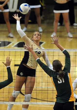 "Nikki Lindow of Colorado hits the ball over Elizabeth Graham of Baylor.<br /> For more photos of the game, go to  <a href=""http://www.dailycamera.com"">http://www.dailycamera.com</a><br /> Cliff Grassmick / October 9, 2010"