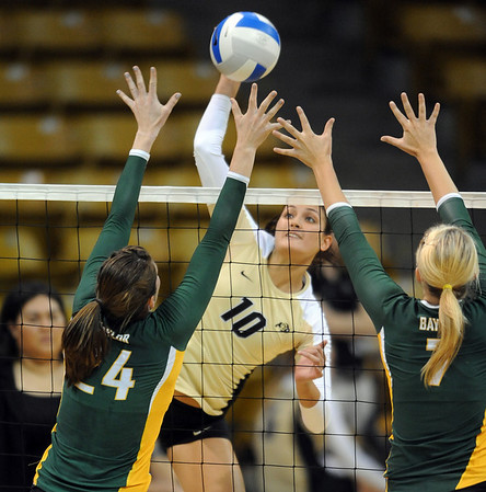 "Anicia Santos of CU tries to hit past Ashlie Christenson (24) and Torri Campbell of Baylor.<br /> For more photos of the game, go to  <a href=""http://www.dailycamera.com"">http://www.dailycamera.com</a><br /> Cliff Grassmick / October 9, 2010"
