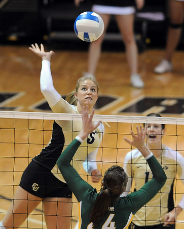 "Nikki Lindow of Colorado hits the ball over Courtney Windham of Baylor.<br /> For more photos of the game, go to  <a href=""http://www.dailycamera.com"">http://www.dailycamera.com</a><br /> Cliff Grassmick / October 9, 2010"