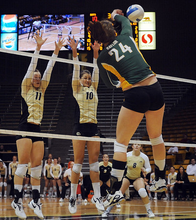 """Rosie Steinhaus (11) and Anicia Santos of CU, go up to block a shot by Ashlie Christenson of Baylor.<br /> For more photos of the game, go to  <a href=""""http://www.dailycamera.com"""">http://www.dailycamera.com</a><br /> Cliff Grassmick / October 9, 2010"""