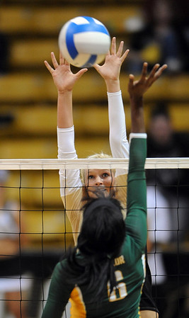 """Kerra Schroeder of Colorado blocks a shot from Ashley Byrd of Baylor.<br /> For more photos of the game, go to  <a href=""""http://www.dailycamera.com"""">http://www.dailycamera.com</a><br /> Cliff Grassmick / October 9, 2010"""