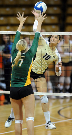 "Anicia Santos of CU tries to hit past Torri Campbell of Baylor.<br /> For more photos of the game, go to  <a href=""http://www.dailycamera.com"">http://www.dailycamera.com</a><br /> Cliff Grassmick / October 9, 2010"