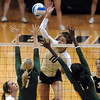 """Anicia Santos of CU tries to hit past  Torri Campbell and Ashley Byrd of Baylor.<br /> For more photos of the game, go to  <a href=""""http://www.dailycamera.com"""">http://www.dailycamera.com</a><br /> Cliff Grassmick / October 9, 2010"""
