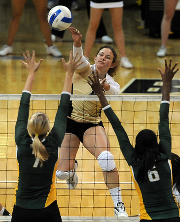 """Richi Bigelow of CU hits the ball over Torri Campbell, left, and Ashley Byrd of Baylor.<br /> For more photos of the game, go to  <a href=""""http://www.dailycamera.com"""">http://www.dailycamera.com</a><br /> Cliff Grassmick / October 9, 2010"""