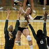 "Richi Bigelow of CU hits the ball over Torri Campbell, left, and Ashley Byrd of Baylor.<br /> For more photos of the game, go to  <a href=""http://www.dailycamera.com"">http://www.dailycamera.com</a><br /> Cliff Grassmick / October 9, 2010"