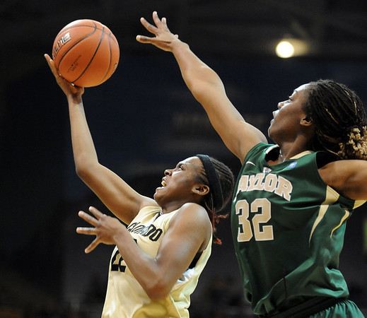 "Brittany Spears of Colorado scores past Brooklyn Pope of Baylor.<br /> For more photos of the game, go to  <a href=""http://www.dailycamera.com"">http://www.dailycamera.com</a>.<br /> Cliff Grassmick / March 5, 2011"