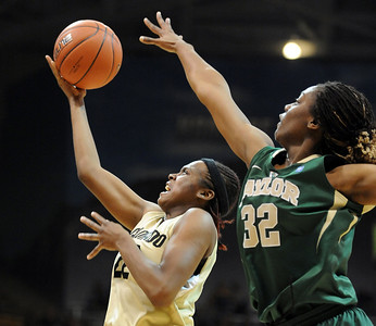 Brittany Spears of Colorado scores past Brooklyn Pope of Baylor. For more photos of the game, go to www.dailycamera.com. Cliff Grassmick / March 5, 2011