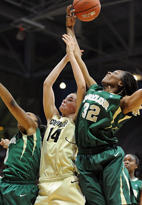 Meagan Malcolm-Peck of CU tries to get a rebound from Brooklyn Pope of Baylor. For more photos of the game, go to www.dailycamera.com. Cliff Grassmick / March 5, 2011