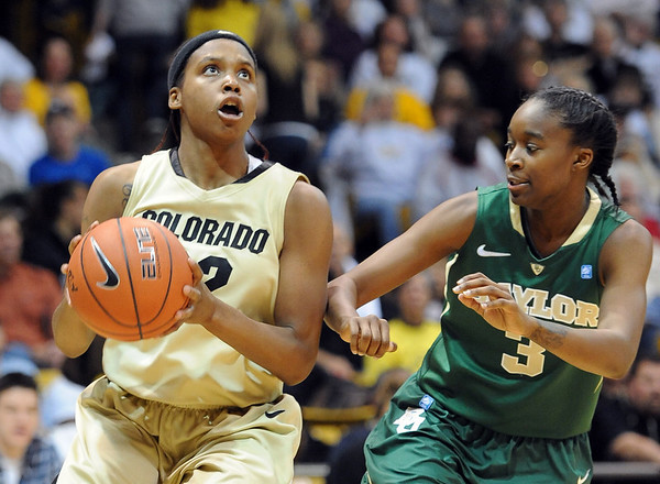 "Brittany Spears of Colorado gets  around  Jordan Madden  of Baylor.<br /> For more photos of the game, go to  <a href=""http://www.dailycamera.com"">http://www.dailycamera.com</a>.<br /> Cliff Grassmick / March 5, 2011"