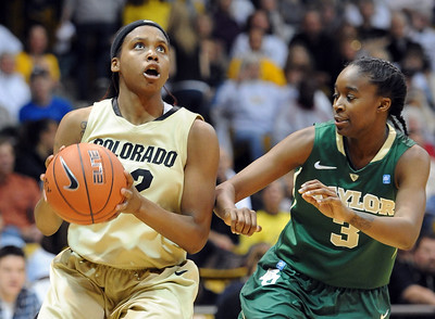 Brittany Spears of Colorado gets  around  Jordan Madden  of Baylor. For more photos of the game, go to www.dailycamera.com. Cliff Grassmick / March 5, 2011