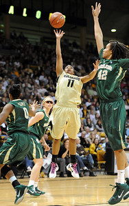 Brittany Wilson of CU, puts up a shot on Brittney Griner of Baylor. For more photos of the game, go to www.dailycamera.com. Cliff Grassmick / March 5, 2011