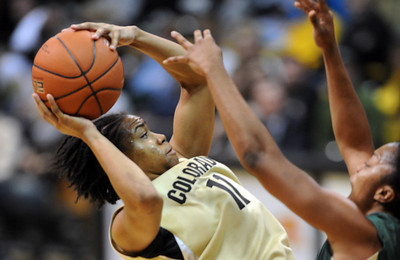 Brittany Wilson of CU puts up a shot on Baylor. For more photos of the game, go to www.dailycamera.com. Cliff Grassmick / March 5, 2011