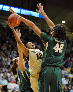 Ashley Wilson of CU, puts up a shot on Brittney Griner of Baylor. For more photos of the game, go to www.dailycamera.com. Cliff Grassmick / March 5, 2011